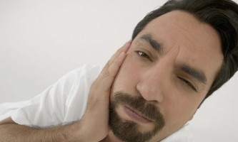 Запалення окістя зуба: причини, симптоми, лікування